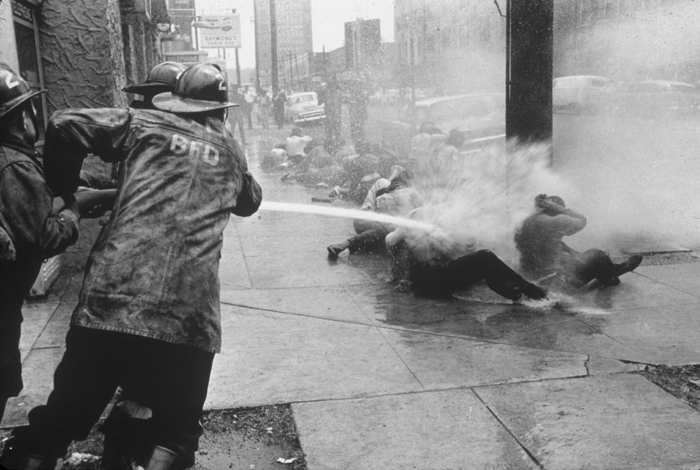 Firemen attack protestors on Double D-Day in Birmingham, AL Credit: 1963 Charles Moore/Black Star